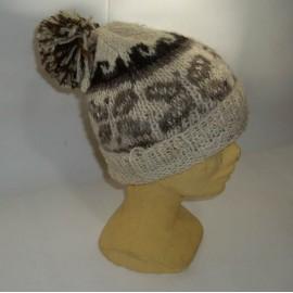 BONNET POMPON Bonnet en laine naturelle